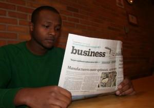 Kamal reads the paper. (Ben Katzner/TommieMedia)