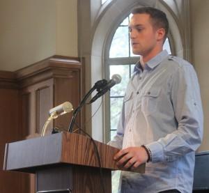 <p>Joe Docter reads a poem at the event. (Rebecca Omastiak/TommieMedia)</p>