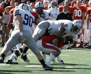 <p>Tommy Becker sacks St. John's quarterback Joe Boyle. The Tommie defense will need to keep pressure on Augsburg quarterback Marcus Brumm, two-time MIAC playter of the week. (John Kruger/TommieMedia)</p>
