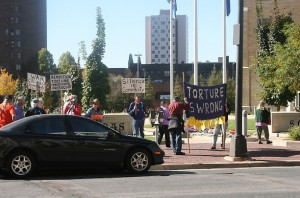 Protesters gathered outside the St. Thomas School of Law Thursday to voice their disapproval of St. Thomas law professor Robert Delahunty and John Yoo, Delahunty's co-author on a series of Justice Department memos. (Katie Broadwell/TommieMedia)