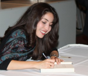 <p>Saberi signs her book outside of OEC auditorium. (Maggie Clemensen/TommieMedia)</p>
