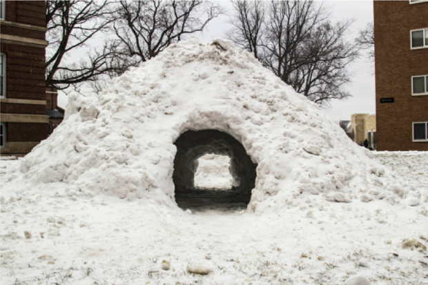 Not to be confused with an igloo, this quinzhee stands in front of the St. John Vianney Seminary on campus. The group of seminary students that fashioned it said they hope it becomes a tradition for future classes. (Carlee Hackl/TommieMedia)