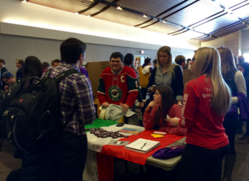 Italian Club members, including President Maya Gardiner and Vice President of Operations Austin Maffie, talk with prospective members at the spring activities fair. Italian professor Danila Cannamela came up with idea for Italian Club. (Emily Sweeney/TommieMedia)
