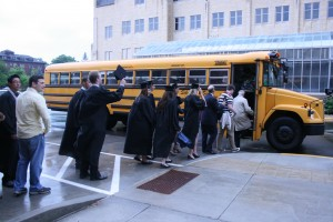 <p>Graduates and their families load onto shuttle buses to get to the Metrodome.</p>