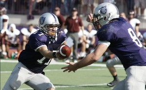 <p>Quarterback Dakota Tracy hands the ball off the running back Ben Wartman. St. Thomas racked up more than 60 points against Hamline last year. (John Kruger/TommieMedia)</p>
