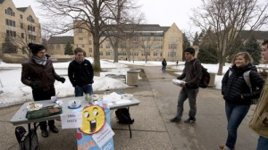 Juniors Hans Pflaumer and John Kharouf of Rock Climbing Club sell brownies to raise money for Haiti relief. (John Kruger/TommieMedia)