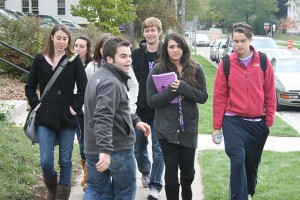<p>Tour guide Corey Dahl leads a group of prospective students around campus Oct. 14, 2009. (TommieMedia file photo)</p>