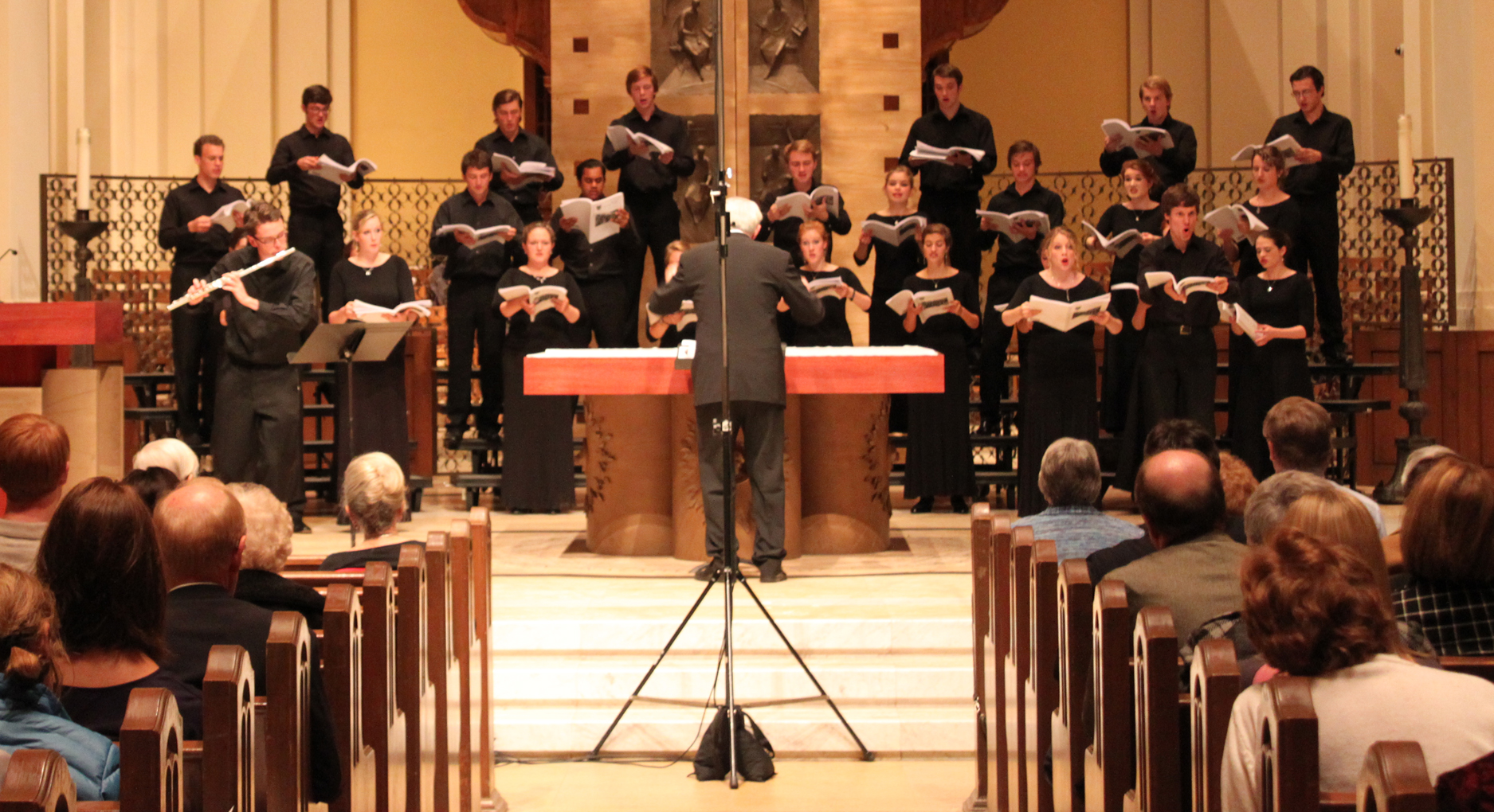 <p>The audience listens as the choir sings a composition from the first half of the performance. (Ariel Kendall/TommieMedia)</p>