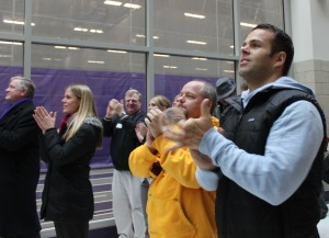 <p>St. Thomas community members cheer as Caruso is named the Liberty Mutual Coach of the year. About 50 people gathered to watch the live announcement in the AARC atrium. (Theresa Malloy/TommieMedia)</p>