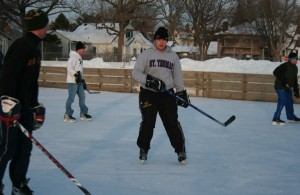 Eric Weslund shoots some puck with friends at Groveland's outdoor ice rink. (Ellie Galgano/TommieMedia)
