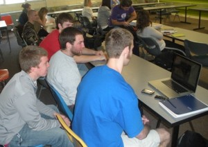 A group of students in Summit Classroom Building watc a game before class starts. (Brian Matthews/TommieMedia)