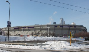 The Minneapolis skyline peers over the roof-less Metrodome. The Dec. 12 roof-collapse caused the St. Thomas baseball team to cancel four games that it was supposed to play there.