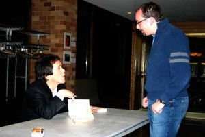 Author Mitch Albom signs a fan's book after his speech Sunday night in the OEC auditorium. (Shane Kitzman/TommieMedia)