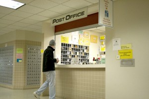 <p>Sophomore Charles Bruchu sends a letter Wednesday afternoon at the post office. (Shane Kitzman/TommieMedia)</p>