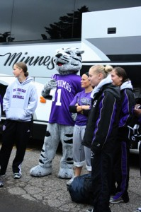 Tommie cheers the softball players on as they pack the bus to leave for their tournament. (Gina Dolski/TommieMedia)