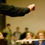 <p>Matthew George directs the Symphonic Wind Ensemble during reherseal this week. The ensemble travels to Italy Jan. 16 - 26 and will play five concerts. (Aaron Hays/TommieMedia)</p>