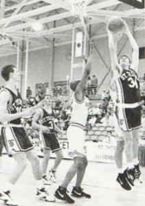 John Tauer, now an assistant men's basketball coach and psychology professor, attempts a layup during a 1993-94 Tommie basketball game.