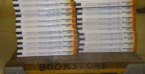 <p>New managerial accounting textbooks sit on a cart outside the bookstore located in the O'Shaughnessy Educational Center. According to the textbooks.com study, 91 percent of students said they saved money when purchasing used textbooks. (Hannah Anderson/TommieMedia)</p>
