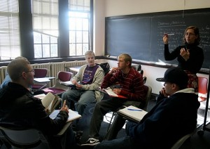 <p>English professor Heather Bouwman discusses writing techniques with students in her English 111 course. After next summer, this course will be replaced with a new course, English 121. (Maggie Clemensen/TommieMedia)</p>